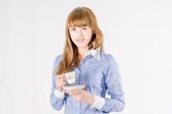 Meisje met een kop Royalty-vrije Stock Afbeelding