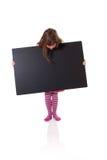 Meisje met een leeg teken royalty-vrije stock afbeeldingen