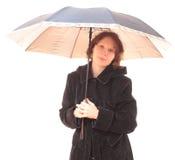 Meisje met een paraplu. stock afbeeldingen