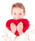 Meisje met een rood hart op een wit Stock Foto