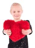 Meisje met een rood hart op een witte achtergrond Stock Afbeelding