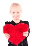 Meisje met een rood hart op een witte achtergrond Royalty-vrije Stock Foto