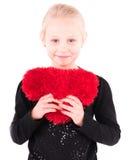 Meisje met een rood hart op een witte achtergrond Stock Foto