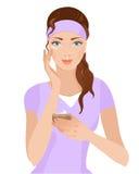 Meisje met een room op haar gezicht Stock Afbeeldingen