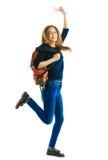 Meisje met een rugzak en kleurenomslagen Royalty-vrije Stock Foto's