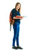 Meisje met een rugzak en kleurenomslagen Stock Afbeelding