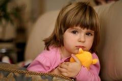 Meisje met een stuk speelgoed Stock Foto