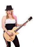 Meisje met elektrische gitaar op wit stock foto's