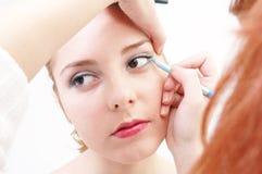 Meisje met eyeliner stock foto
