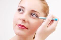 Meisje met eyeliner Stock Afbeelding