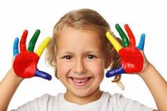 Meisje met geschilderde handen Stock Afbeeldingen
