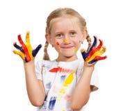 Meisje met geschilderde handen Stock Foto