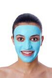 Meisje met gezichtsmasker Stock Foto's