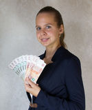 Meisje met in hand geld Stock Fotografie