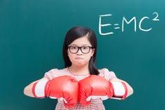 Meisje met handschoen en e=mc2 royalty-vrije stock afbeeldingen