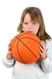 Meisje met het lange geïsoleerder basketbal van de haarholding Royalty-vrije Stock Afbeeldingen