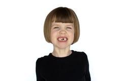 Meisje met het missen van tanden het glimlachen Stock Foto