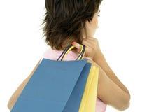 Meisje met het winkelen zakken Stock Foto's