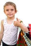 Meisje met het winkelen zakken op witte achtergrond O.k. stock afbeelding