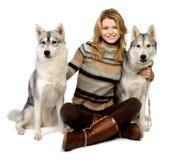 Meisje met honden Stock Foto's