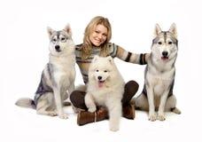 Meisje met honden Stock Afbeelding