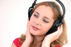 Meisje met hoofdtelefoon in een diepe trance stock foto's