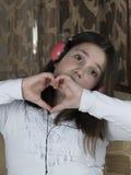 Meisje met hoofdtelefoons stock fotografie