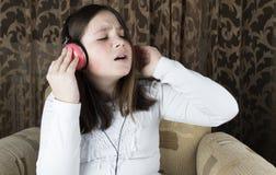Meisje met hoofdtelefoons royalty-vrije stock foto