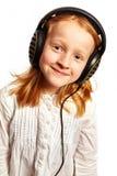 Meisje met hoofdtelefoons in een lichte hoogste mening Royalty-vrije Stock Afbeeldingen