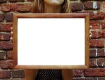 Meisje met houten frame Stock Foto's