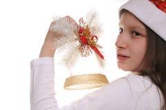 Meisje met Kerstmisklok Stock Foto's