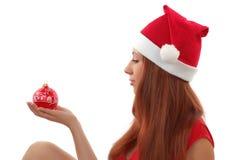 Meisje met Kerstmisstuk speelgoed Stock Afbeelding