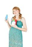 Meisje met kosmetische containers Stock Foto's