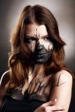 Meisje met makup op zwarte achtergrond Stock Afbeelding