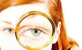 meisje met meer magnifier Stock Fotografie