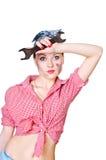 Meisje met moersleutel die haar brow afveegt Stock Fotografie