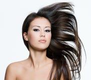 Meisje met mooie lange bruine haren Stock Foto