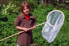 Meisje met netten voor vlinder royalty-vrije stock afbeelding