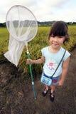 Meisje met netto vlinder royalty-vrije stock afbeelding