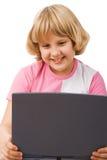 Meisje met notitieboekjecomputer Stock Foto's