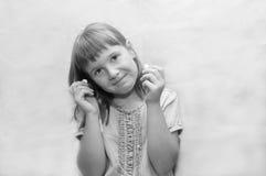 Meisje met oortelefoons Royalty-vrije Stock Foto's