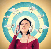 Meisje met oortelefoons Royalty-vrije Stock Afbeelding