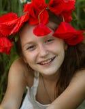 Meisje met papavers Stock Afbeeldingen