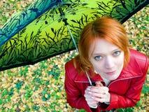 Meisje met paraplu Stock Foto's