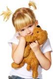 Meisje met puppystuk speelgoed Stock Foto's
