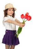 Meisje met rode tulpen stock fotografie
