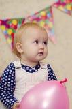 Meisje met roze ballon Stock Foto's