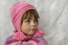 Meisje met roze pompons Stock Foto
