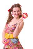 Meisje met roze spiraalvormige lollys Royalty-vrije Stock Foto