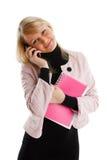 Meisje met schrijven-boeken en telefoon Stock Afbeelding